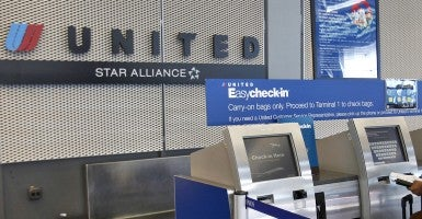 Traveler checks in using United Airlines kiosk at the O'Hare International Airport in Chicago. (Photo: Newscom)