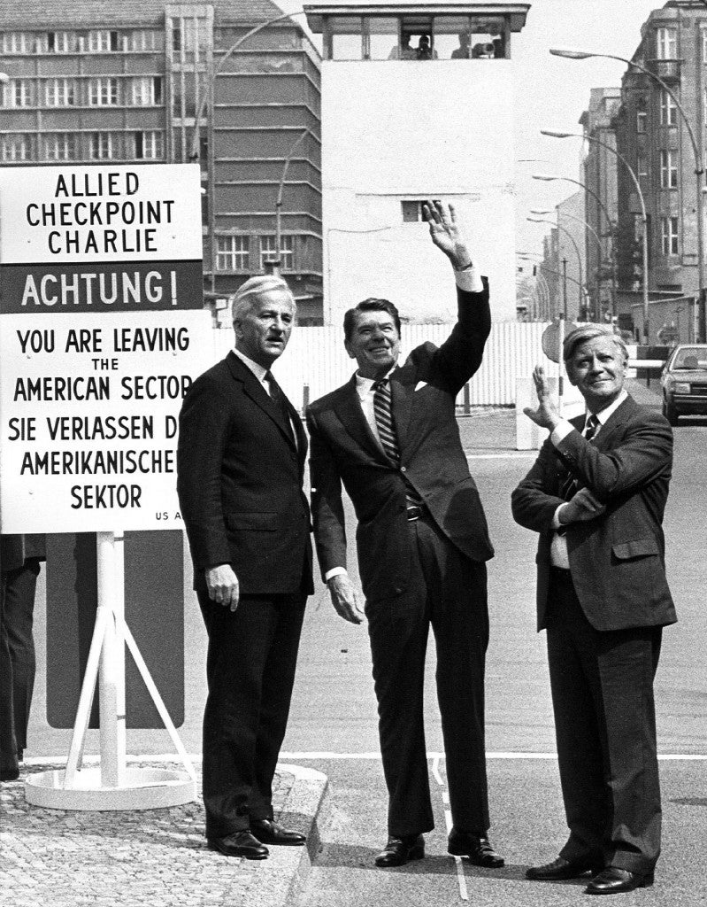 epa01913010 (FILE) A file picture dated 11 June 1982 shows (L-R) then Berlin Mayor Richard von Weizsecker, then US President Ronald Reagan and then German Chancellor Helmut Schmidt at Check Point Charlie in Berlin, Germany.   'Tear down this wall!'. On 12 June 1987, US President Ronald Reagan pronounced these words to Soviet leader Mikhail Gorbachev during a speech at the Brandenburg Gate commemorating the 750th anniversary of Berlin. The Berlin Wall came down two years later on 09 November 1989 and two parts of Germany was reunified after 28 years of separation. The building of the Wall began on 13 August 1961. German Democratic Republic (GDR) armed forces started to seal off the eastern part of the city with road barriers made from barbed wire, to build an 'anti-Fascist protective barrier.' On 09 November 1989, after the spokeperson of German Democratic Republic government Guenter Schabowski announced during a press conference the immediate opening of the inner German border, tens of thousands of GDR citizens flocked to the border crossing points. The Iron Curtain fell. On 09 November 2009 will be the celebration of this historic autumn night, the celebration of the 20th anniversary of the fall of the Berlin Wall.  EPA/DIETER HESPE    B/W ONLY (Newscom TagID: epaphotosfour391456.jpg) [Photo via Newscom]
