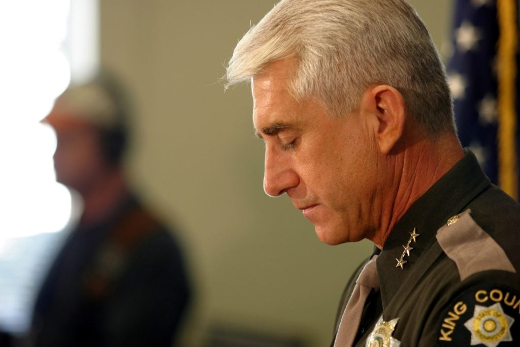 "Rep. Dave Reichert, R-Wash., then the sheriff of King County in Washington State, composes himself during a press conference in 2003 after Gary Ridgway plead guilty to the infamous ""Green River"" murders. (Photo: Kevin P. Casey/EPA/Newscom)"