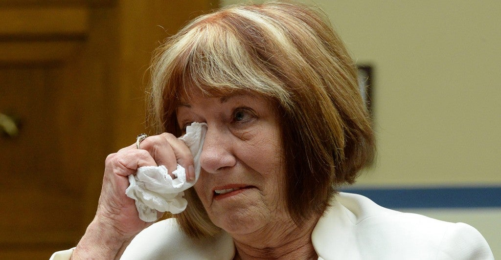Patricia Smith, mother of American Sean Smith who was killed in the Benghazi attack, wipes away tears while testifying during the US House Oversight and Government Reform Committee hearing on 'Reviews of the Benghazi Attacks and Unanswered Questions', on Capitol Hill September 10, 2013. (Photo: Michael Reynolds/Newscom)