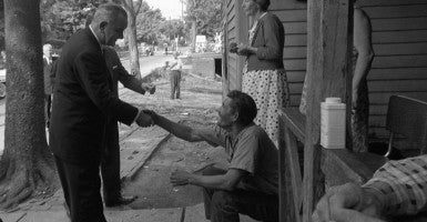 LBJ's War on Poverty. President Lyndon Johnson shakes hands with an Appalachian resident. May 7, 1964. (Photo: Newscom)