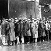 Unemployed men queued outside a soup kitchen o