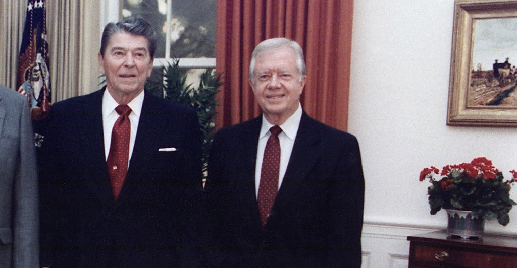 Ronald Reagan and Jimmy Carter in 1991. (Photo: Newscom)