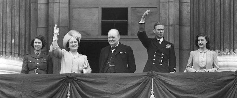 British Royal Family waves to crowds on Victory in Europe Day, May 8, 1945. Prime Minister Winston Churchill takes the central position of honor on the Buckingham Palace balcony. Princess Elizabeth, wear her ATS Uniform, Queen Elizabeth, King George and Princess Margaret join Churchill. (Photo: Newscom)