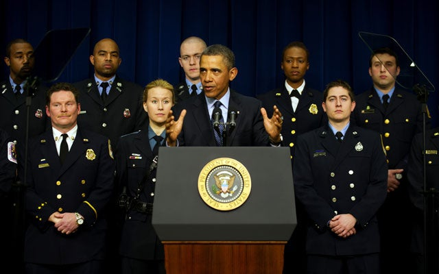 President Obama warns against sequestration with a backdrop of emergency responders. (Photo: JIM WATSON/AFP/Getty Images/Newscom)