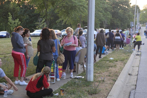 Hundreds wait in line for section 8 housing vouchers in Bloomington, Indiana, in July. (Photo: Polaris)