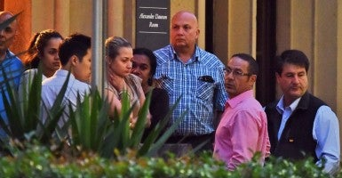 The relatives of the hostages from the siege at the Lindt chocolate cafe in Martin Place gather in Sydney. Police have confirmed three people are dead and four are injured after a dramatic end to a 16-hour siege at the Lindt cafe. (Photo: Newscom)
