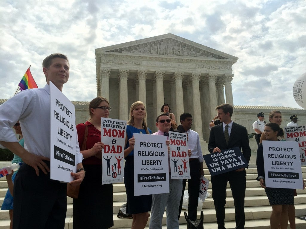 Traditional marriage advocates hold signs in front of the Supreme Court on Thursday, June 25. (Photo: Samantha Reinis/The Daily Signal)