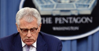 Amid crises, Obama pushes out Hagel as Defense Secretary. (Photo: Newscom)