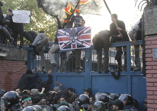 Iranian student demonstrators climb over the wall of the British Embassy during a protest on November 29, 2011 in Tehran, Iran. UPI/Maryam Rahmanian