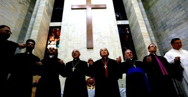 Priests offer prayers during a service for around 600 Iraqi Christian refugees at a church in Hazmiyeh, near Beirut. (Photo: Jamal Saidi/Reuters/Newscom)