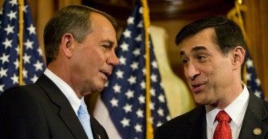 John Boehner speaks with Darrell Issa outside the House floor. (Photo: Jay Mallin/Zuma Press/Newscom)