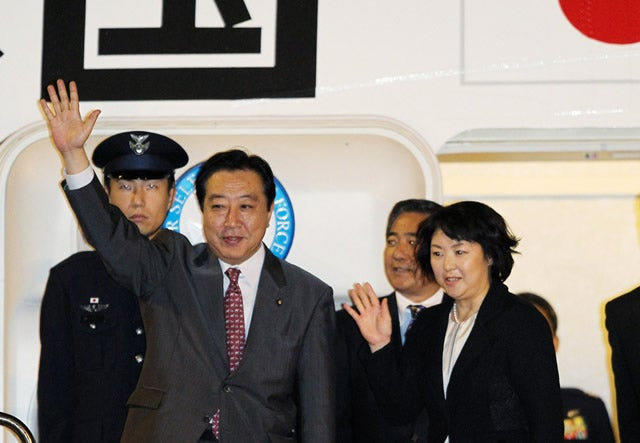 Japanese Prime Minister Yoshihiko Noda (L), accompanied by his wife Hitomi, waves as he leaves from Tokyo International Airport to New York to attend the UN General Assembly on September 20, 2011. Noda will meet with US President Barack Obama during his international debut after coming to office earlier this month. AFP PHOTO / JIJI PRESS