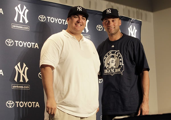 New York Yankees Derek Jeter stands next to Christian Lopez, the man who caught hit number 3000
