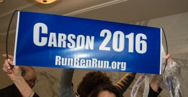 Ben Carson, here heralded by a fan last week at CPAC, is formally looking into a race for president. (Photo: Jeff Malet/Newscom)