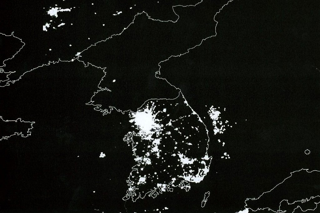 A satellite photo of the Korean Peninsula that shows the bright lights of South Korea and China compared to the blackness of North Korea at night. (Photo: Flickr)