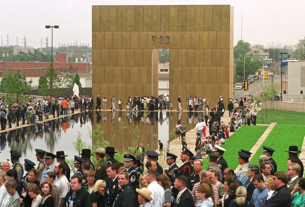 Participants and visitors to the Oklahoma City National Memorial gather around the reflecting pool on Wednesday, April 19, 2000 for a five-year memorial ceremony. (Photo: Horiz/Newscom)