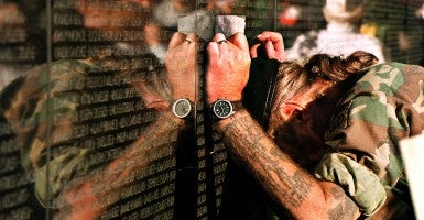 Doc Sorenson of Stanton, Virginia leans his head against the Vietnam Veterans Memorial. He made a rubbing of Lloyd Miller, a friend of Sorenson's brother. (Photo: Pete Souza/Newscom)