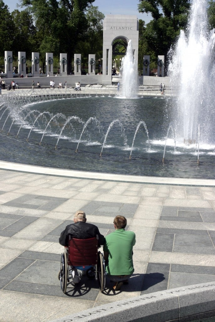 Delaware resident E. Vincent Lee, a WWII veteran and POW visits the National World War II Memorial with grandson Charles McLeod in Washington, DC, on April 29, 2004.  (Photo: Chuck Kennedy/Newscom)