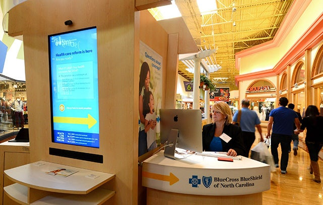 Photo: Kelli Tremblay, an authorized agent with BlueCross BlueShield of North Carolina, works a station at Concord Mills. (Photo: Jeff Siner/Charlotte Observer/MCT)