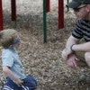 Lucas Dean, 4, plays in a park with his father Jay
