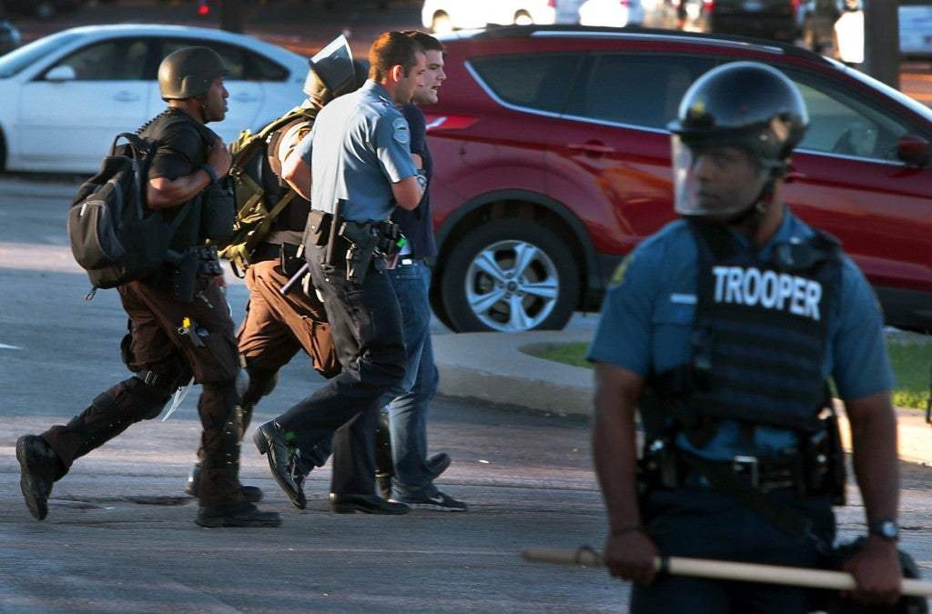 Huffington Post reporter Ryan J. Reilly is arrested trespassing when police officers  closed a Ferguson, Mo., McDonald's restaurant on West Florissant Avenue on Wednesday, Aug. 13, 2014. (Photo: Robert Cohen/St. Louis Post-Dispatch/MCT)