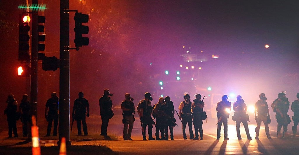 Tactical officers on the evening of Aug. 13 work their way north on West Florissant Avenue in Ferguson, Mo. (Photo: Robert Cohen/St. Louis Post-Dispatch/MCT)