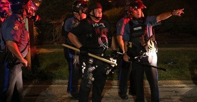 Police point out protesters of interest Aug. 18 in Ferguson, Mo. (Photo:  J.B. Forbes/St. Louis Post-Dispatch/MCT)