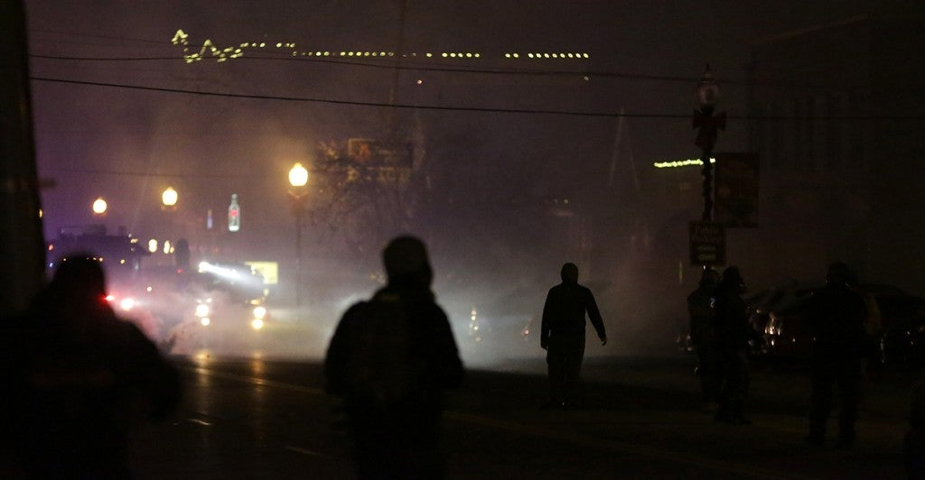 The streets of Ferguson, Mo. were dark and loud all night long after the grand jury made its announcement. (Photo: Armando Sanchez/Newscom)