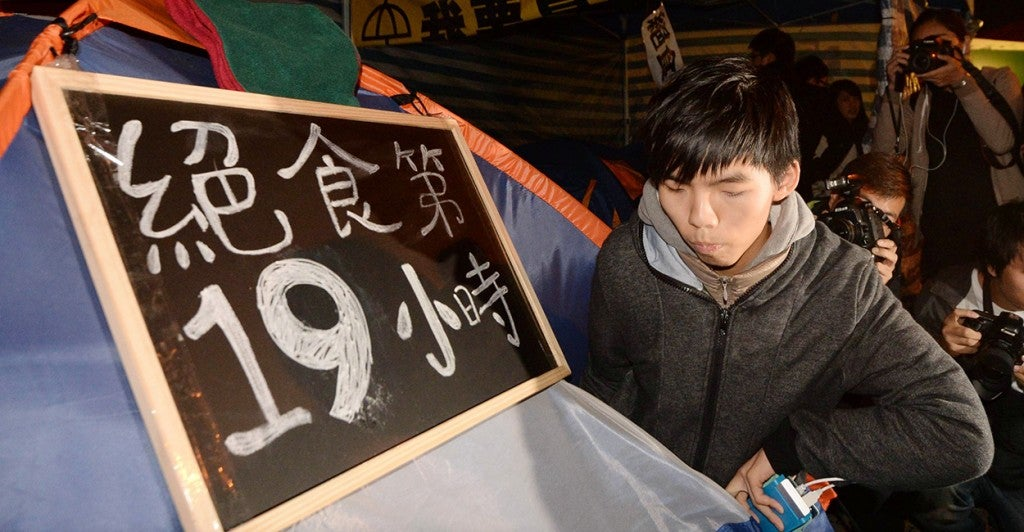 Joshua Wong, head of Hong Kong student group Scholarism, continues his indefinite hunger strike in the Admiralty district of the territory on Dec. 2, 2014. Wong, 18, along with two student members began the hunger strike the previous day to press for a second round of talks with the government over Beijing's decision on Hong Kong's upcoming leadership election. (Photo: Kyodo/Newscom)