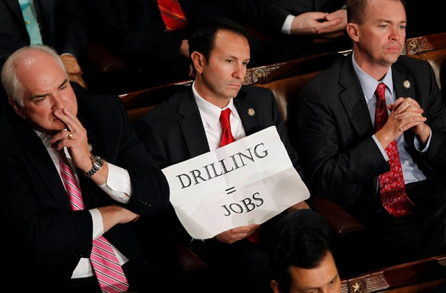 U.S. Representative Landry holds a sign in his lap during U.S. President Obama's address to a joint session of Congress on Capitol Hill in Washington