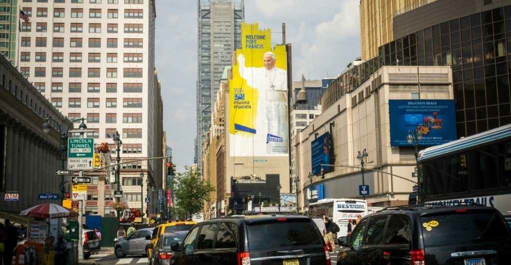 An unfinished billboard near Madison Square Garden is adorned with the image of Pope Francis prior to his visit to New York, seen on Monday, August 31, 2015. (Photo: Richard B. Levine/Newscom)