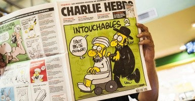"A 2012 issue of Charlie Hebdo featuring the satirical drawing titled ""Intouchables 2."" (Photo: Newscom)"
