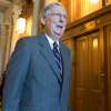Senate Majority Leader Mitch McConnell, R-Ky., walks to a Friday meeting