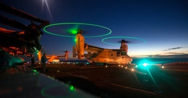 U.S. Marines with Special-Purpose Marine Air-Ground Task Force Crisis Response-Africa practice landings MV-22B Ospreys at night aboard the amphibious assault ship USS Kearsarge (LHD 3), in the Mediterranean Sea, Oct. 19, 2015. (U.S. Marine Corps photo by Cpl. Jalen D. Phillips/ Released)