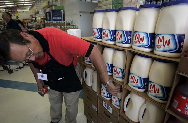 Man re-stocks Miracle Whip in grocery store