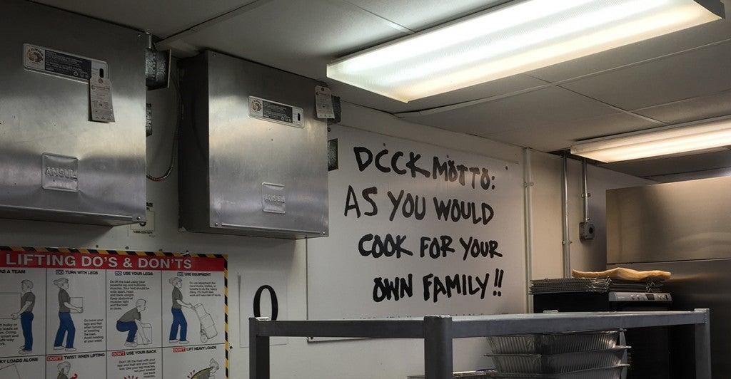 The D.C. Central Kitchen motto hangs in the kitchen. (Photo: Madaline Donnelly/The Daily Signal)