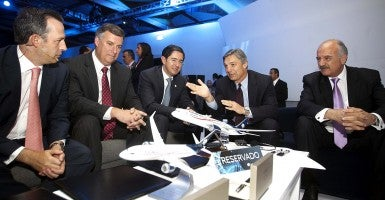 President and CEO of Boeing with other global aviation executives. (Photo: Newscom)