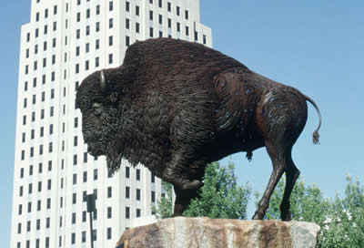 Bison statue and state capitol building, Bismarck, North Dakota