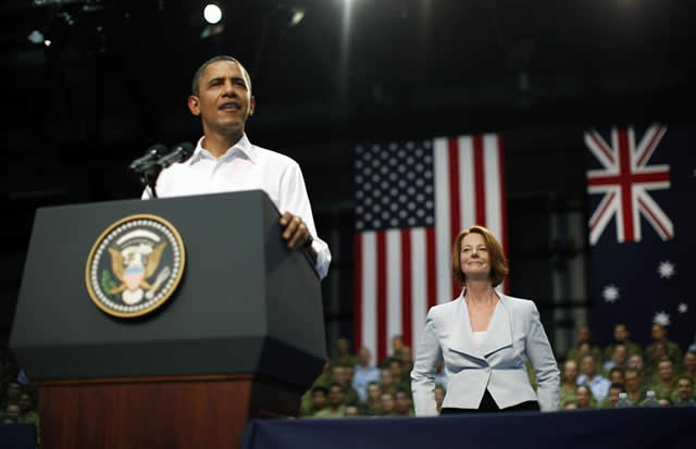 President Barack Obama addresses Australian troops and U.S. Marines as Australian Prime Minister Julia Gillard watches on at the Royal Air Force Base in Darwin, northern Australia, November 17, 2011. REUTERS/Jason Reed