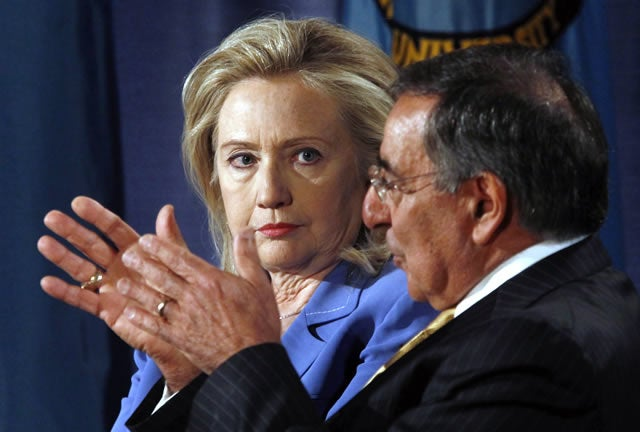 U.S. Secretary of State Hillary Rodham Clinton and Secretary of Defense Leon Panetta (R) take part in a televised conversation at the National Defense University in Washington August 16, 2011. REUTERS/Kevin Lamarque