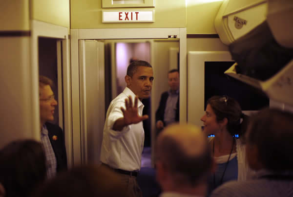 President Barack Obama gestures as he steps aboard Air Force One in Peoria August 17, 2011.