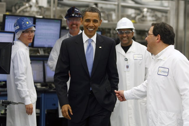 President Barack Obama tours the Solyndra solar panel company with (rt) Ben Bierman, Executive Vice President of Engineering of Solyndra, in Fremont, California, on May 26, 2010. EPA/PAUL CHINN/POOL