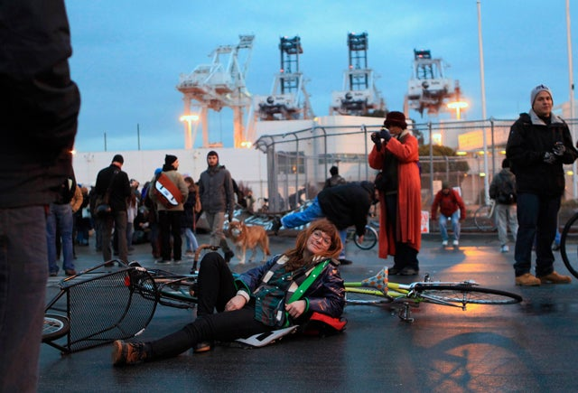Demonstrators gather at a gate to the Port of Oakland