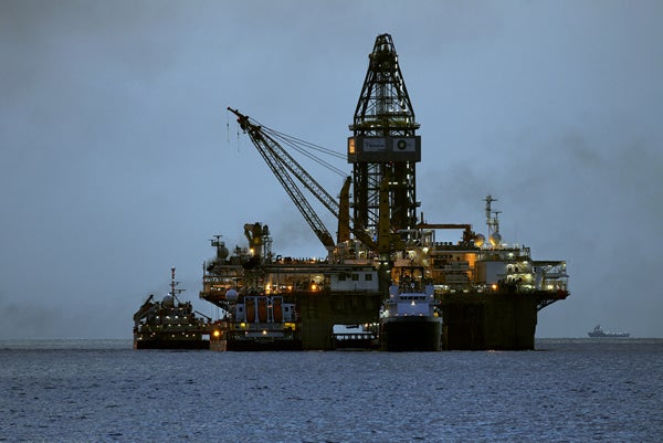 Oil rig drilling in ocean