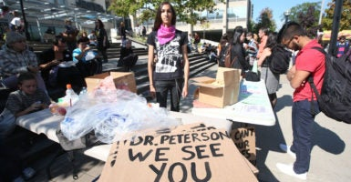 Cassandra Williams, a student union member at the University of Toronto, poses in front of sign at a free speech protest centered on professor Jordan Peterson. (Photo: Vince Talotta/Toronto Star/Newscom)