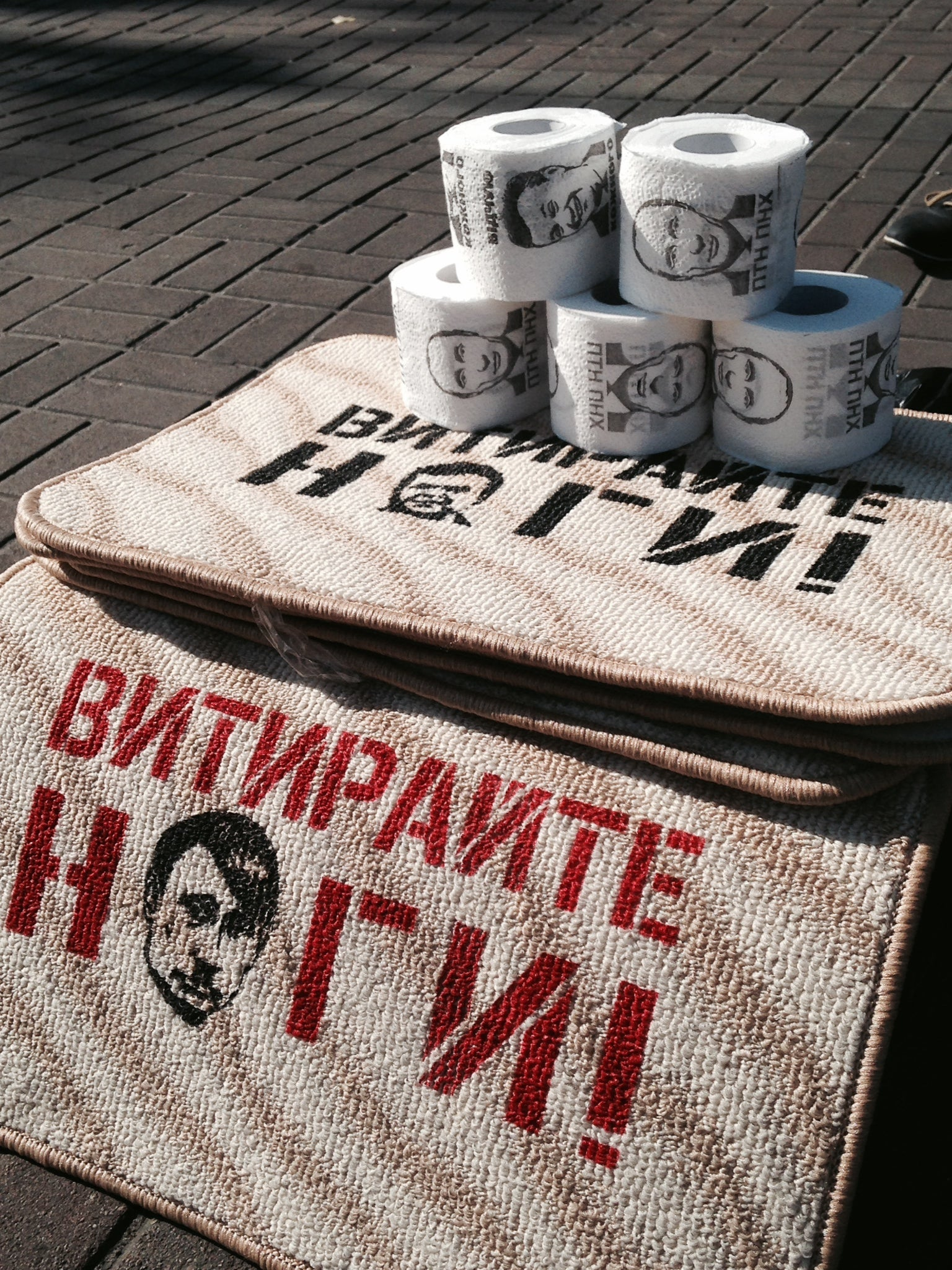 Depictions of Russian President Vladimir Putin for sale on Kyiv's Independence Square. (Photo: Nolan Peterson/The Daily Signal)
