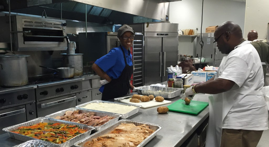 Central Union Mission's first female chef, Susan Page, alongside STP student Jamie Pointer. (Photo: Madaline Donnelly/The Daily Signal)