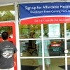 People arrive to sign up for health insuran
