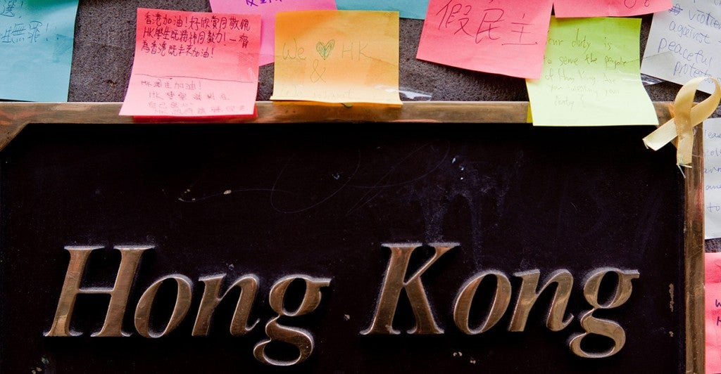 A colorful demonstration supporting the Hong Kong democracy protests has spontaneously sprouted on the walls of Hong Kong House in the central business district in Sydney, Australia. (Photo: Tasso Taraboulsi/Newscom)